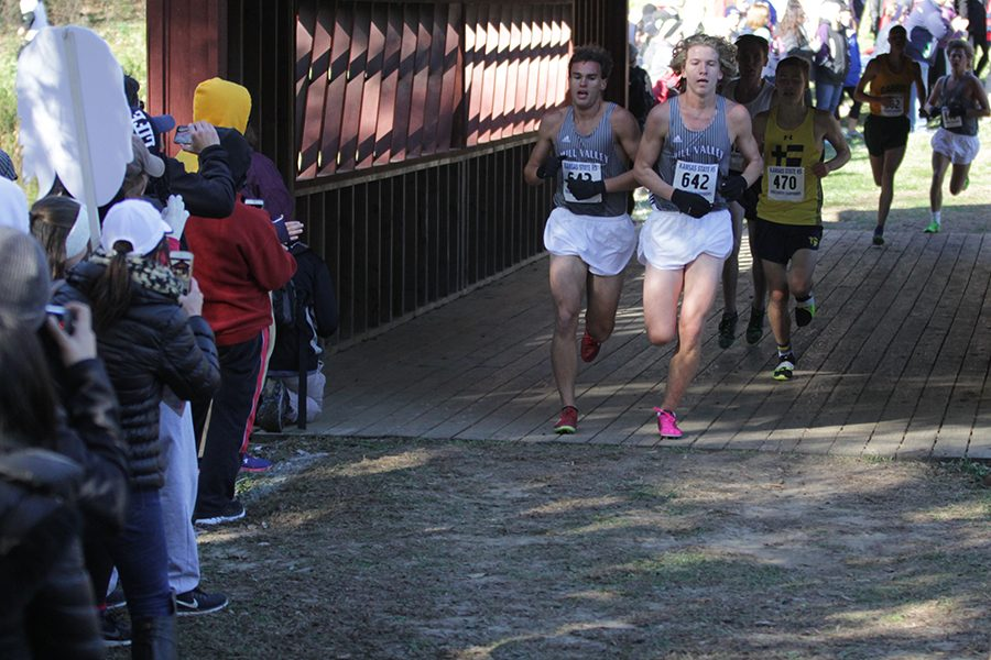 Exiting+the+bridge%2C+seniors+Justin+Grega+and+Mitch+Dervin+keep+the+same+pace+at+the+cross+country+state+championships+on+Saturday%2C+Oct.+28.