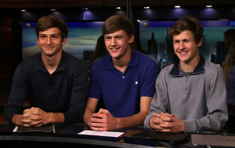 While visiting the Fox 4 News studio, sophomore Riley Ferguson, and juniors Blake Aerni and Noah Smith sit behind the news desk in Studio A on Tuesday, Oct. 24.