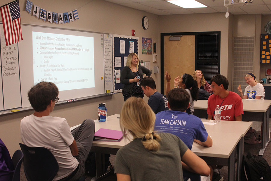 Addressing the class, consumer science teacher Emily Schmidt informs her students of their daily agenda.