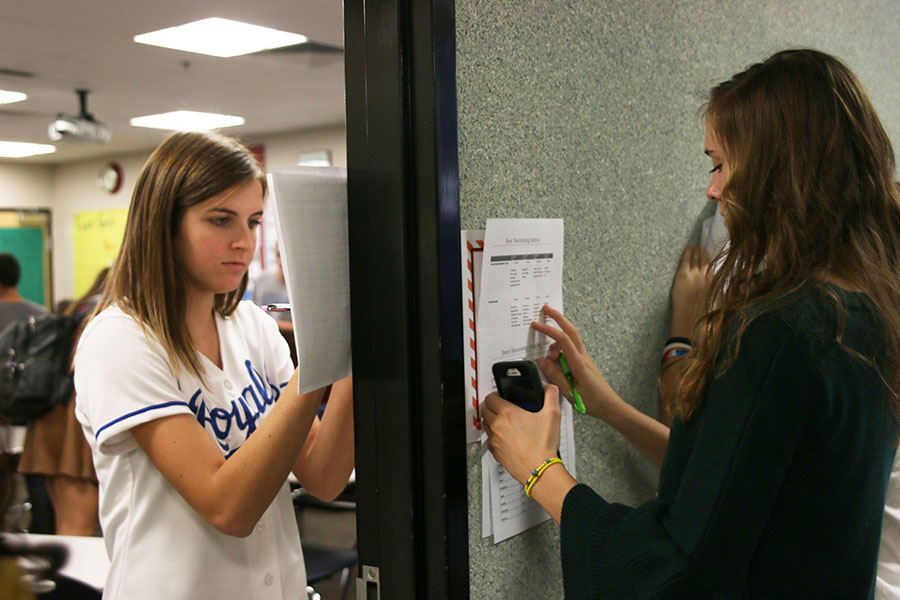 Juniors Jessie Leininger and Erin Miller judge the doors for Red Ribbon Week on Thursday, Oct. 26.