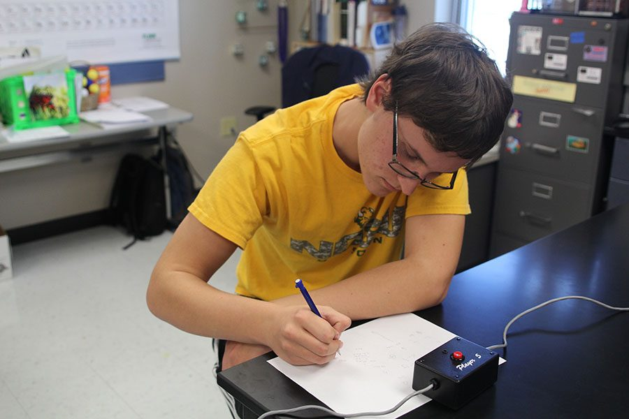 At a Quiz Bowl practice on Monday, Oct. 23, junior Will Hect solves a math problem.