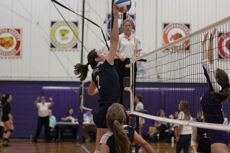 Senior+Ava+Taton+hits+the+ball+over+the+net.