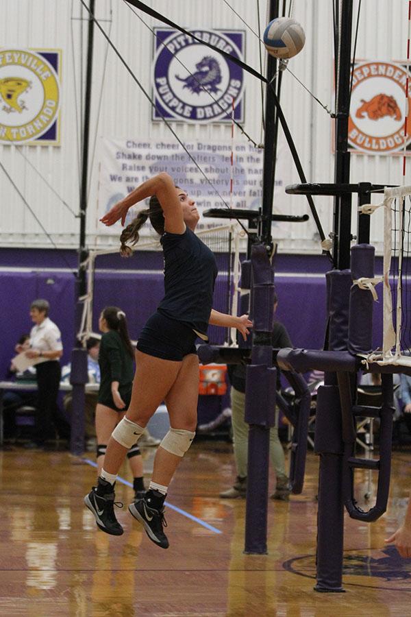Senior+Allie+Harvey+jumps+up+to+hit+the+ball.
