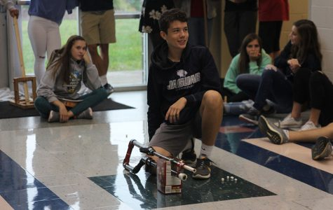 Preparing for his turn to launch his marshmallow on Tuesday, Oct. 10, junior TJ Smith listens to science teacher Chad Brown's instructions.