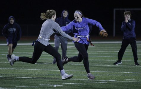 Avoiding the tackle, junior Claire Kaifes gets ready to throw the ball down field, resulting in the juniors win over the seniors on Monday, Nov. 6.