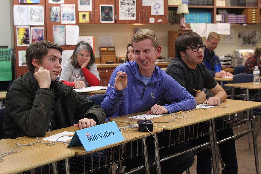 After+getting+the+correct+answer%2C+senior+Landon+Butler+smiles+at+his+teammates+during+the+Quiz+Bowl+meet+at+Eudora+High+School+on+Wednesday%2C+Nov.+15.+