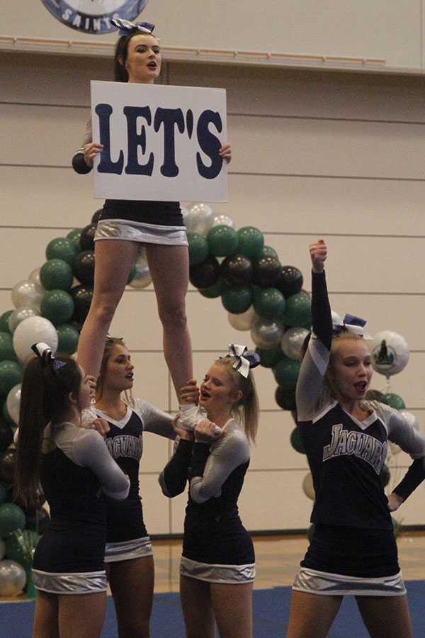 Senior+Heather+Winne+stands+in+her+stunt+holding+up+the+%22Let%27s%22+sign+in+%22Let%27s+go+Jags.%22