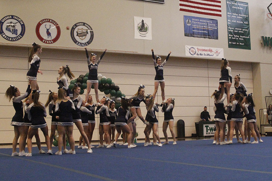 The+cheerleaders+prepare+for+their+final+stunt.