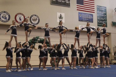 For the final stunt of the routine, eight fliers hold hands in the competition on Saturday, Nov. 11.
