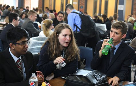 During the lunch break, debate coach Ann Goodson gives advice to sophomore Srikar Turaga and freshman Benjamin Wieland during their competition on Saturday, Nov. 4.
