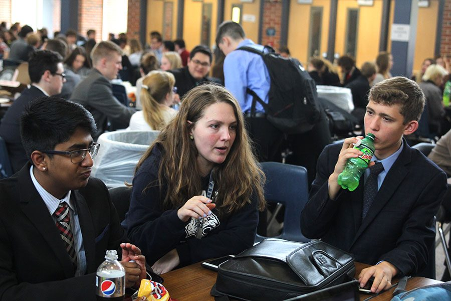 During+the+lunch+break%2C+debate+coach+Ann+Goodson+gives+advice+to+sophomore+Srikar+Turaga+and+freshman+Benjamin+Wieland+during+their+competition+on+Saturday%2C+Nov.+4.