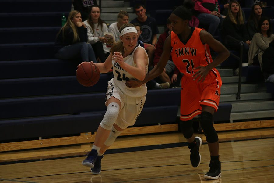 During the Lady Jags game against Shawnee Mission Northwest on Thursday Nov. 30, Evan Zars drives to the basket.