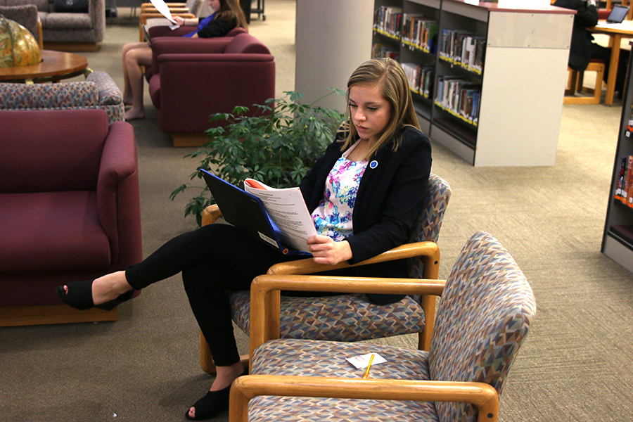 Looking at the test, junior Caroline Ratledge competes at the Leavenworth  High School DECA meet.