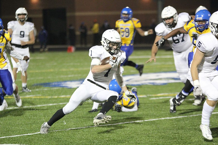 Cutting across to avoid members of the opposing team, junior Cameron Young runs upfield, resulting in a 57-12 win against Schlagle on Friday, Nov. 3.
