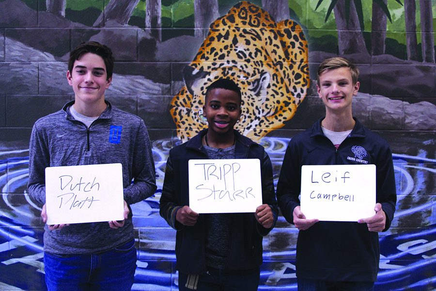 Sophomore Tripp Starr along with freshmen Leif Campbell and Dutch Platt stand together on Monday, Nov. 13 displaying their uncommon names on whiteboards.