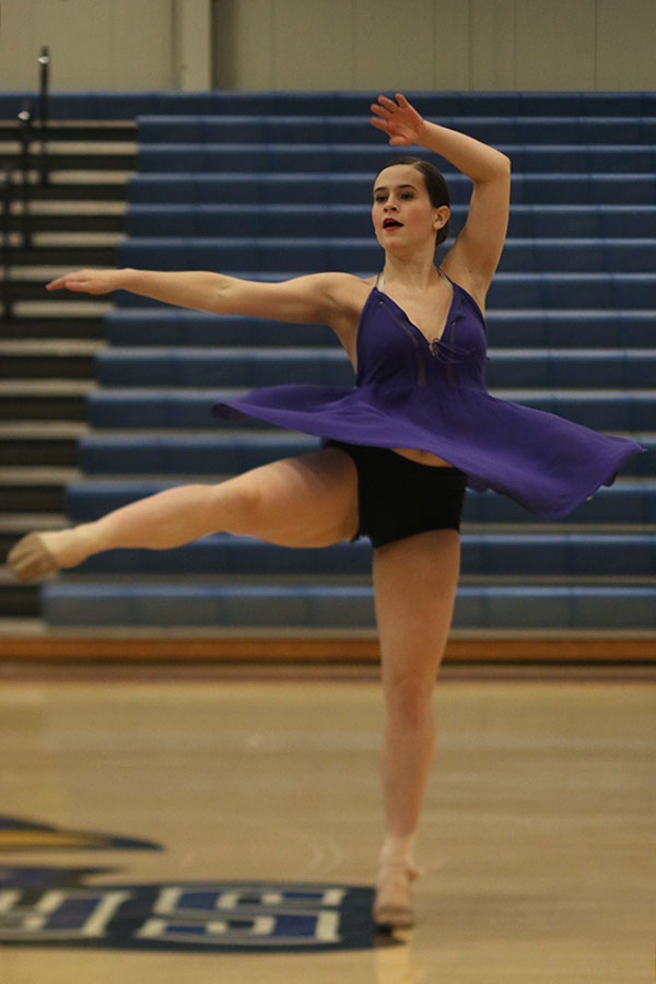Turning+during+her+solo%2C+junior+Olivia+Augustine+performs+at+the+Kansas+City+Classic+on+Saturday%2C+Dec.+9.