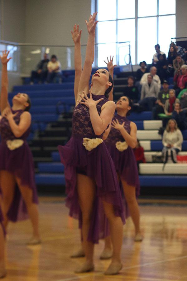 Reaching+up%2C+freshman+Lauren+Acree+dances+in+the+jazz+routine+on+Saturday%2C+Dec.+9.