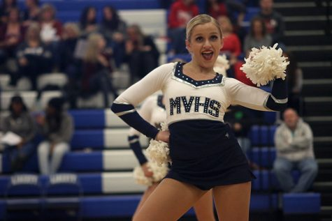 At the Kansas City Classic on Saturday, Dec. 9, junior Bella Line dances in the pom routine.
