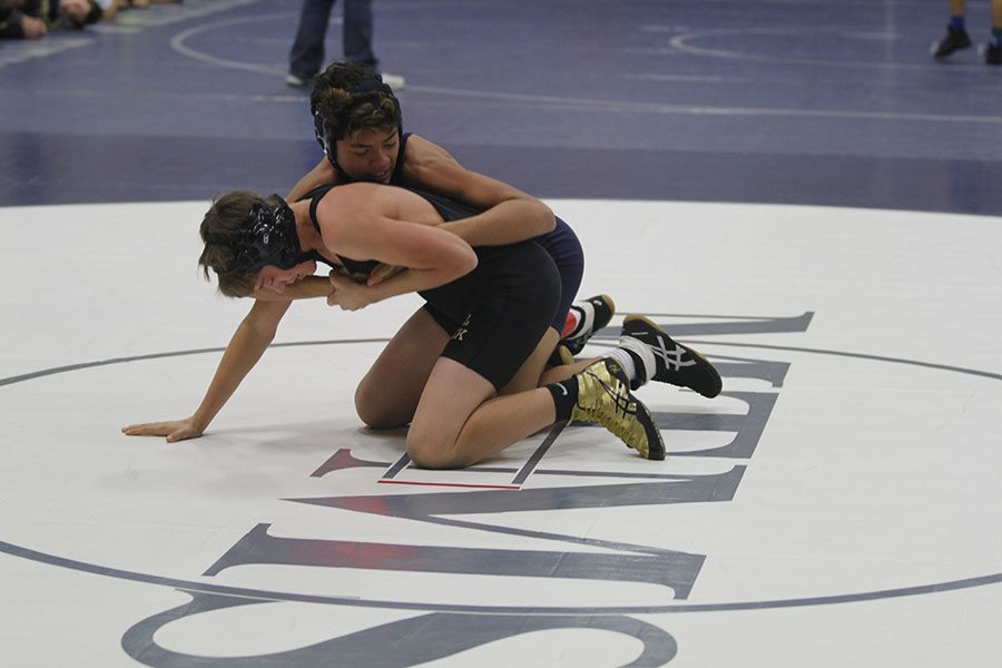 At the quad hosted by Monticello Trails Middle School on Wednesday, Nov. 28, a MTMS wrestler attempts to defeat his opponent.