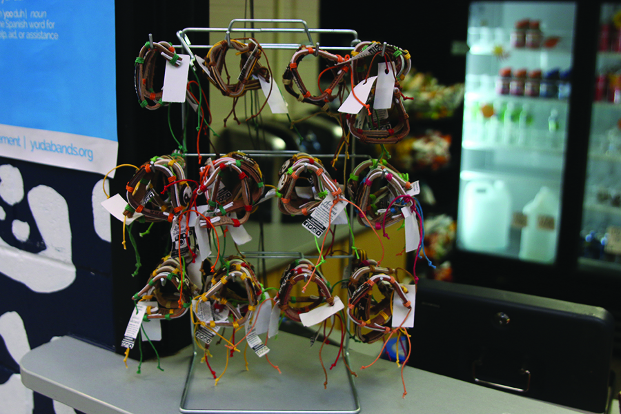 Being displayed in front of the Catty Shack, the Yuda bands shown appear in a variety of style and design on Monday, Dec. 11. All proceeds went to the fundraiser for the disaster, which took place between December 2-13.