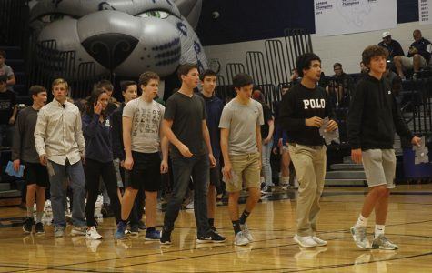 Lead by sophomore Anthony Pentola, a group of students walk out of the Jaguar head to be recognized at the academic letter ceremony on Friday, Dec. 1.