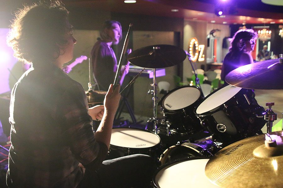"While rehearsing on Monday, Dec. 4, sophomore Cael Duffin plays the drums with his class from School of Rock.  ""It's the interconnectedness that School of Rock has that makes it less of a band and more of a family,"" Duffin said."