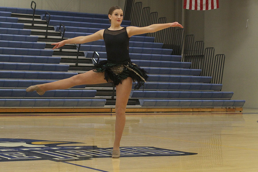 Freshman+Kenzie+Harris+hits+a+pirouette+during+her+solo.+Her+routine+placed+third+in+the+freshman+division.