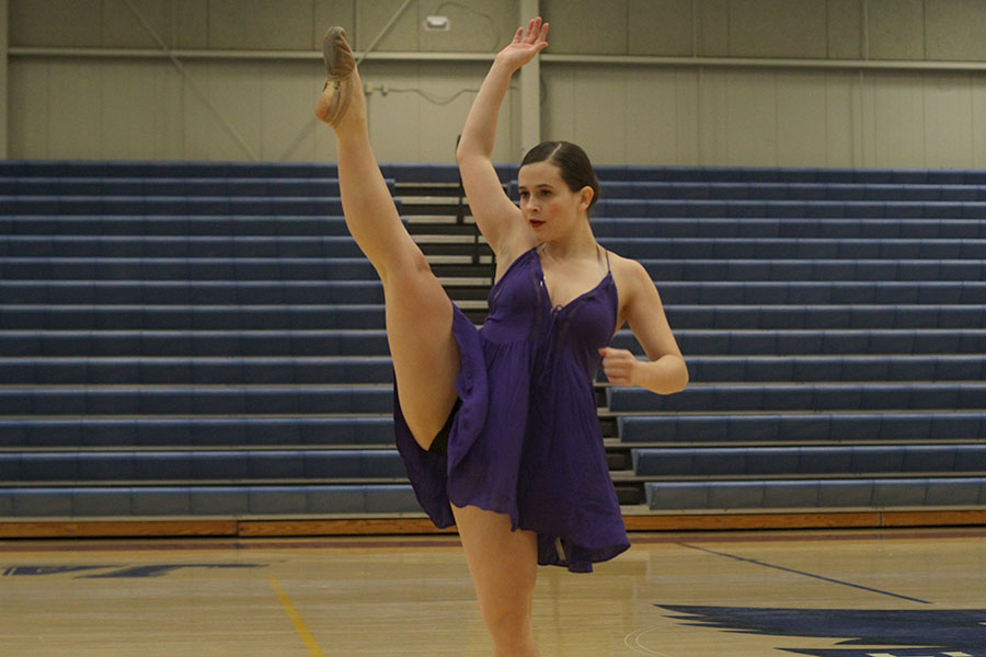 Adding+a+touch+of+emotion+to+her+face%2C+junior+Olivia+Augustine+performs+her+solo.