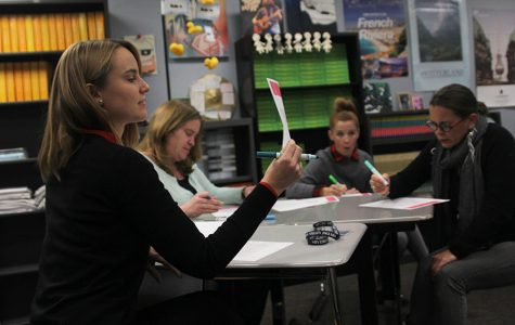 During the English Professional Learning Community meeting on Tuesday, Dec. 6, English teacher Anna Nelson examines and discusses with fellow English teachers the accreditation rubric for the district. // Victoria Wright