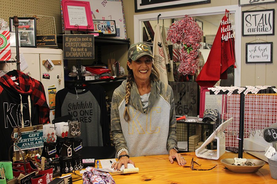 Owner+Kristina+Gann-Albright+stands+behind+the+register+of+her+boutique+ShananiGanns+located+on+Johnson+Drive.