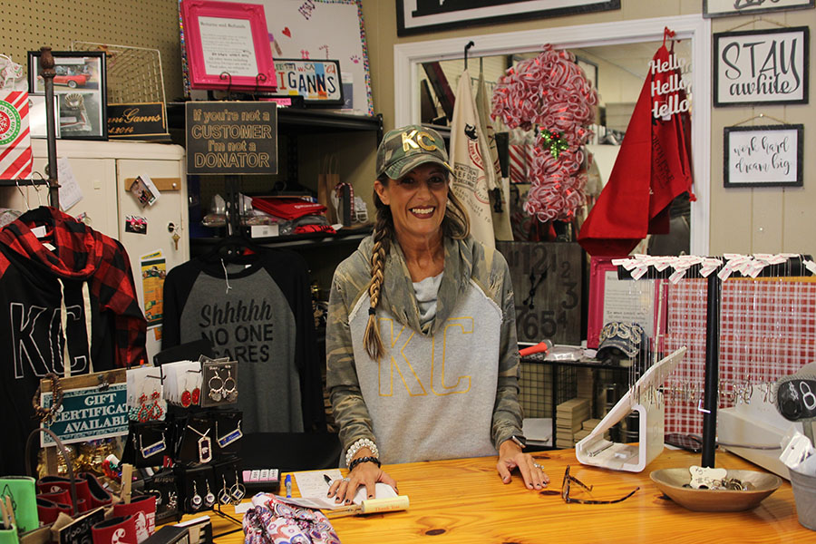 Owner Kristina Gann-Albright stands behind the register of her boutique ShananiGanns located on Johnson Drive.