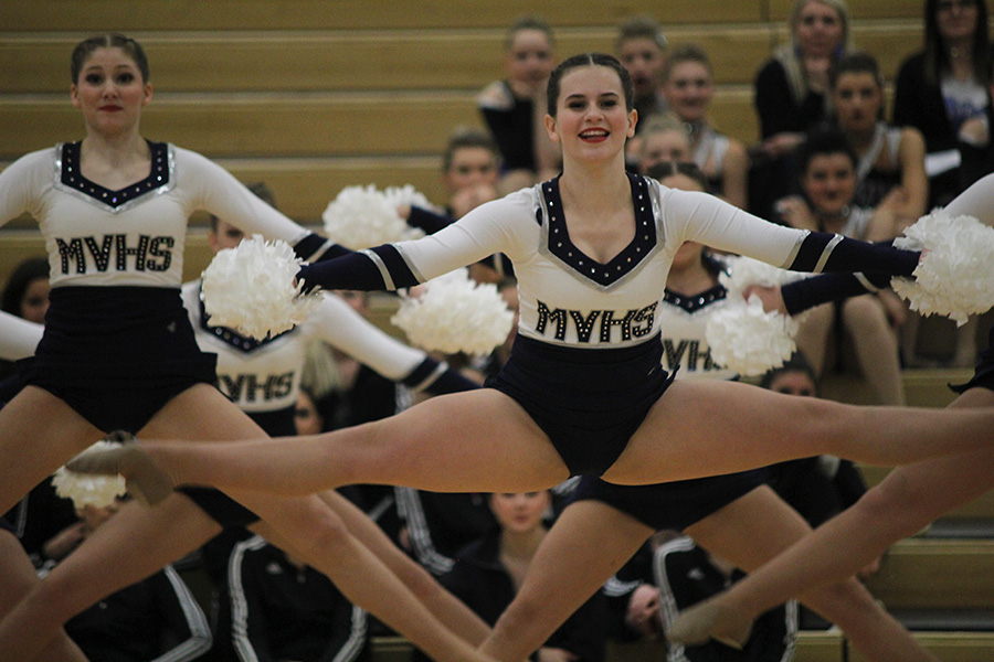 Doing+a+toe+touch%2C+junior+Olivia+Augustine+performs+the+pom+routine+on+Saturday%2C+Jan.+13.