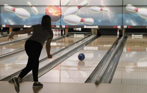 In order to get a spare, sophomore Bri Laluk attempts to knock down her last pin at Olathe Lanes East Bowling Center on Monday, Jan. 22.