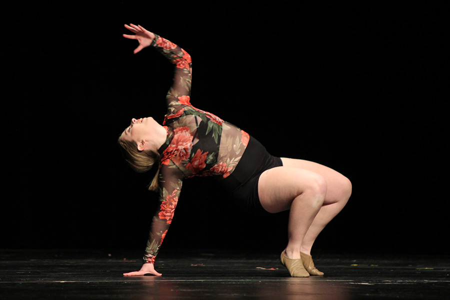 Hitting+a+pose%2C+senior+Emma+Barge+performs+her+solo+at+the+Miss+Kansas+competition+on+Friday%2C+Jan.+12.