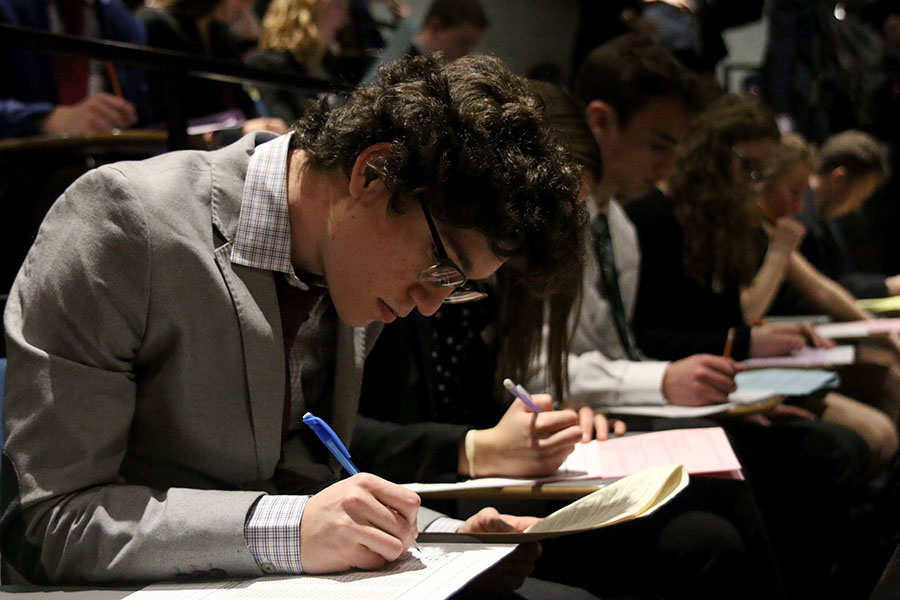 Looking at the test, senior Daniel Nicot competes in the Blue Valley High School Invitational DECA meet on Wednesday, Jan. 31.