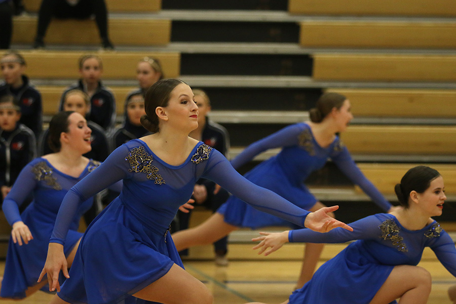 Reaching+out%2C+freshman+Kenzie+Harris+competes+at+the+Miss+Kansas+dance+competition.+