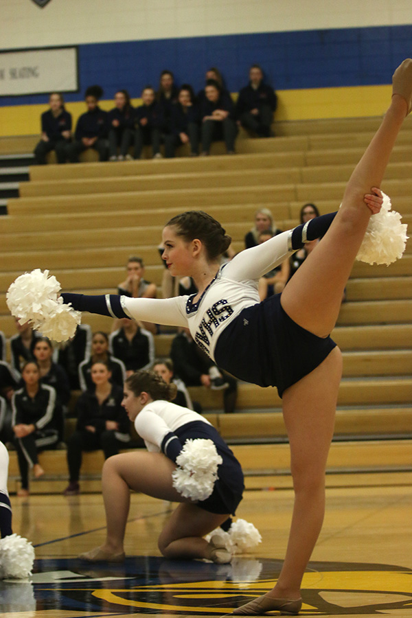 With+her+leg+outstretched%2C+freshman+Tyler+Bret+does+her+part+during+the+pom+routine+on+Saturday%2C+Jan.+13.