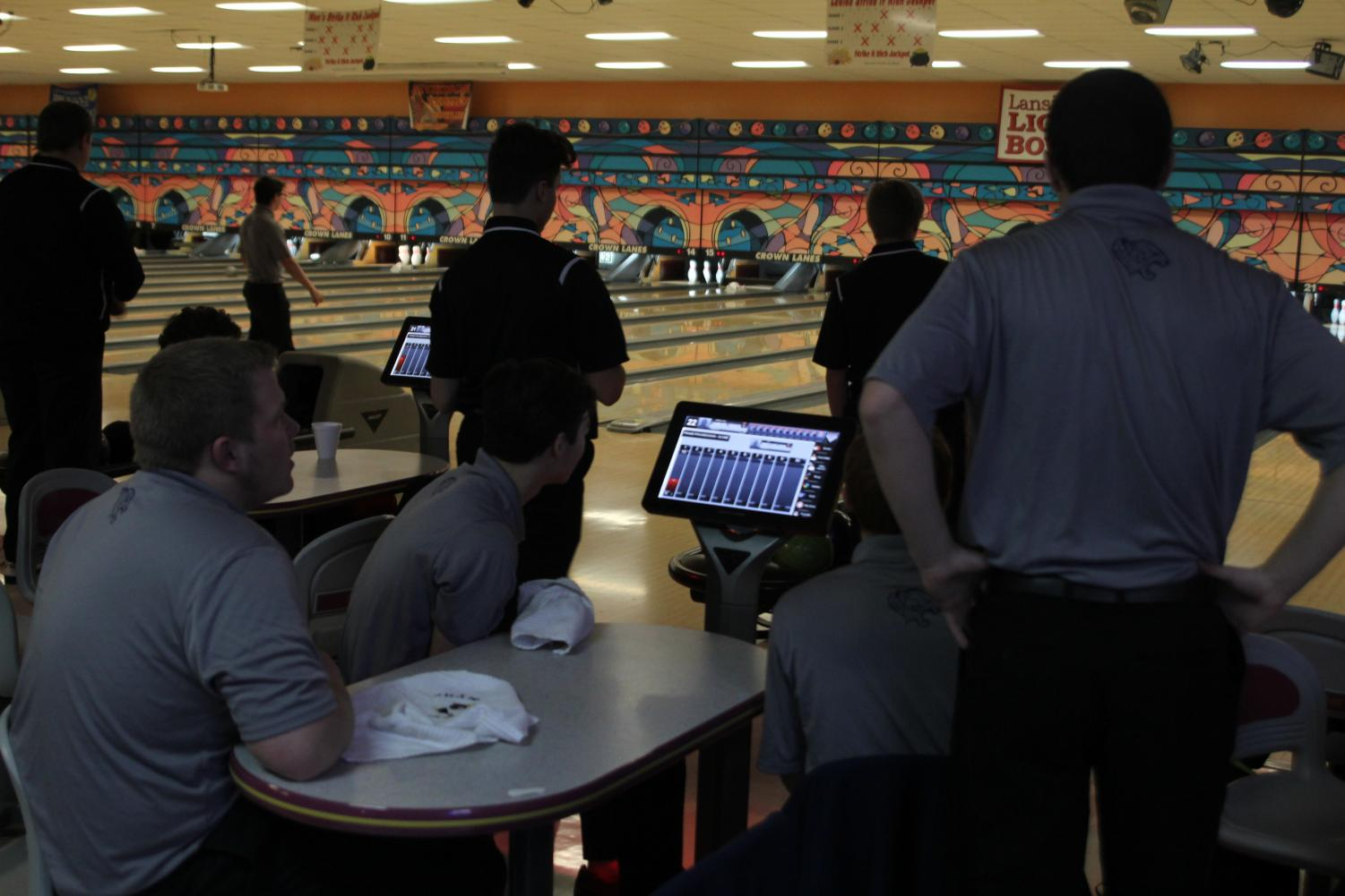 Preparing to begin the frame, seniors Trey Callahan, Brent Stevenson, Bradley Teasley and Clark Harris discuss their strategy for the meet. The bowling meet was held in Leavenworth at Crown Lanes versus Lansing on Tuesday, Jan. 16.