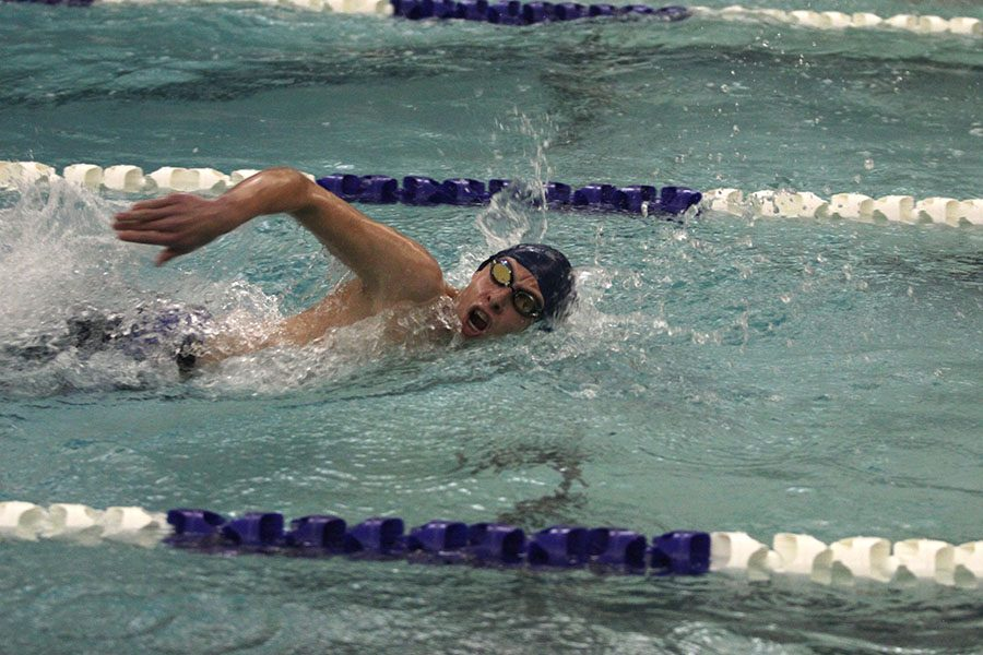 Sprinting to the end of the pool, sophomore Avery Lawson swims his leg of the 400 yard freestyle relay.