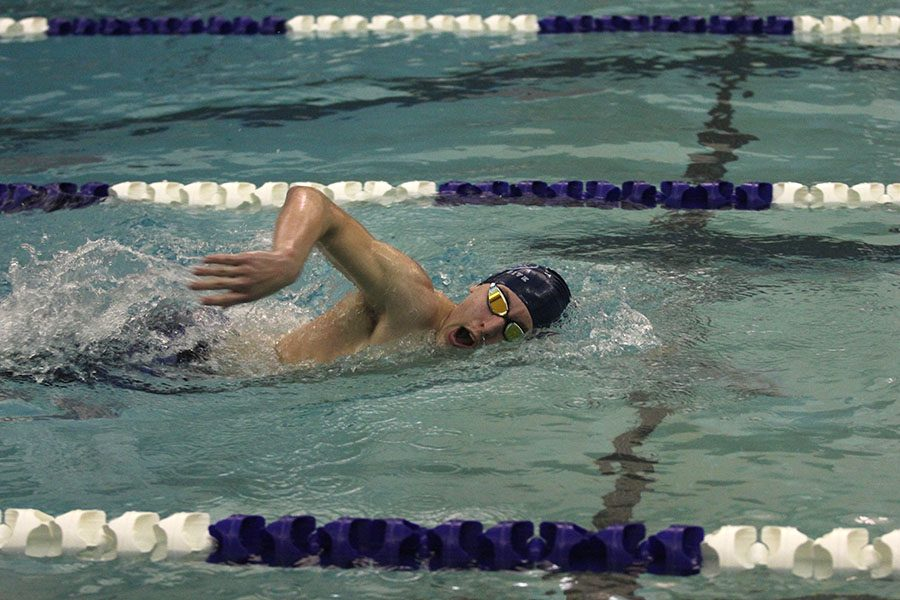 Stroking forward, sophomore Colby Beggs competes in the 500 yard freestyle.