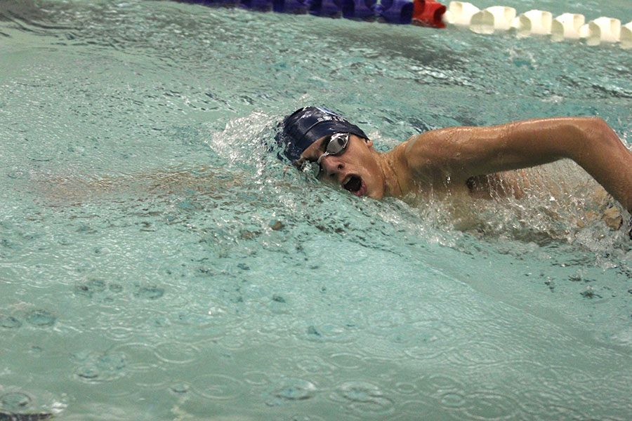 Turning for a breath, freshman Cole McClure swims the 500 free at Chisholm Trail Middle School on Wednesday, Jan. 17.