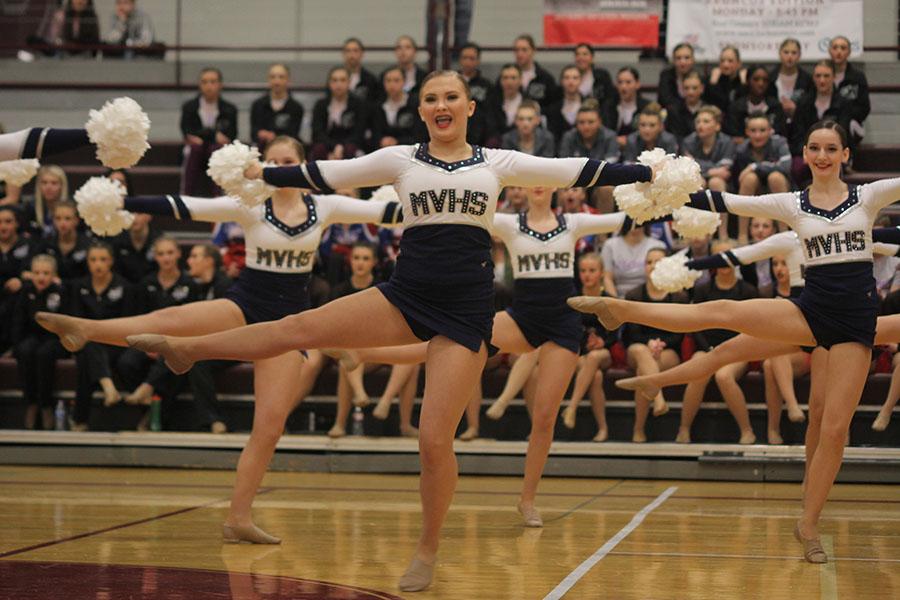 Freshman+Jenna+Haase+dances+in+the+pom+routine.