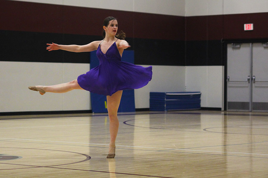 Junior+Olivia+Augustine+pirouettes+in+her+solo+routine.