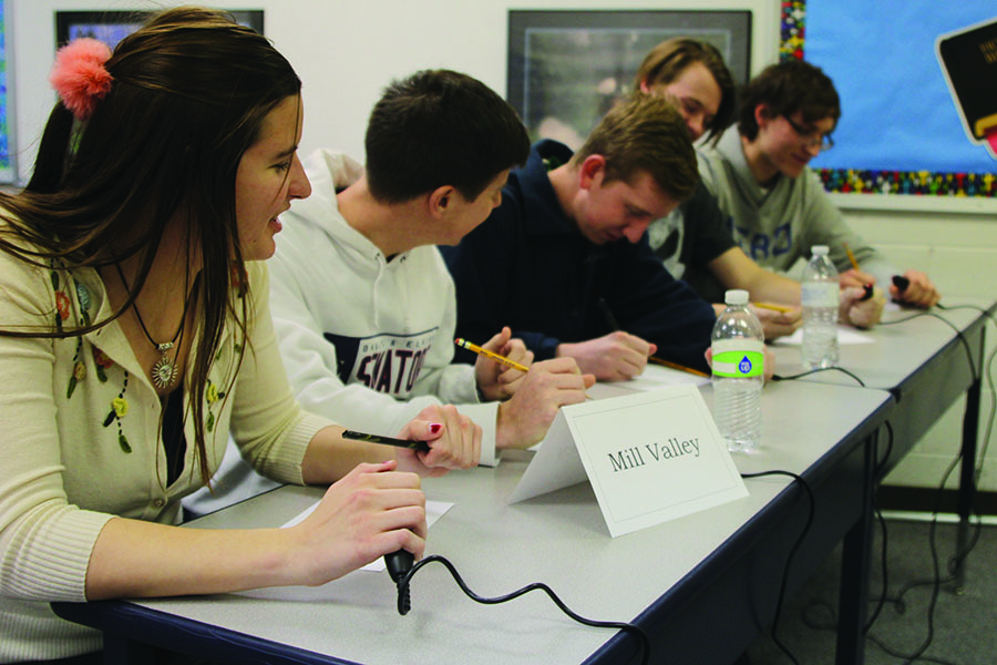 The quiz bowl team briefly discusses a math question at a meet at Maranatha Christian Academy. The team swept the competition and won the meet on Wednesday, Jan. 18.
