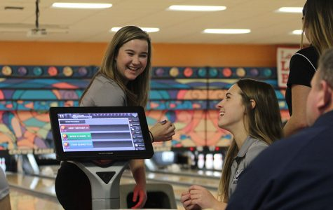 In between frames, sophomore Bri Laluk and senior Emily Jackson bond at the Crown Lanes bowling tournament on Tuesday, Feb. 6.