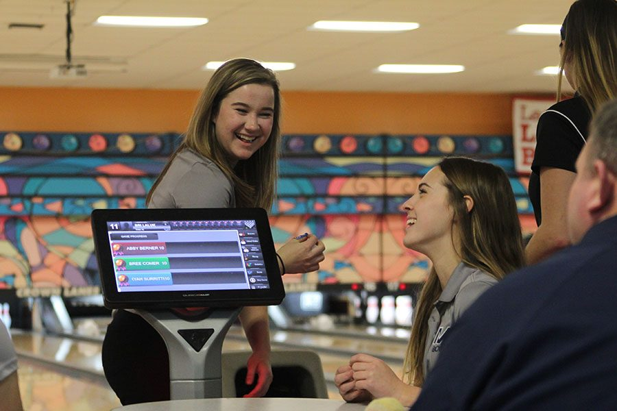 In+between+frames%2C+sophomore+Bri+Laluk+and+senior+Emily+Jackson+bond+at+the+Crown+Lanes+bowling+tournament+on+Tuesday%2C+Feb.+6.