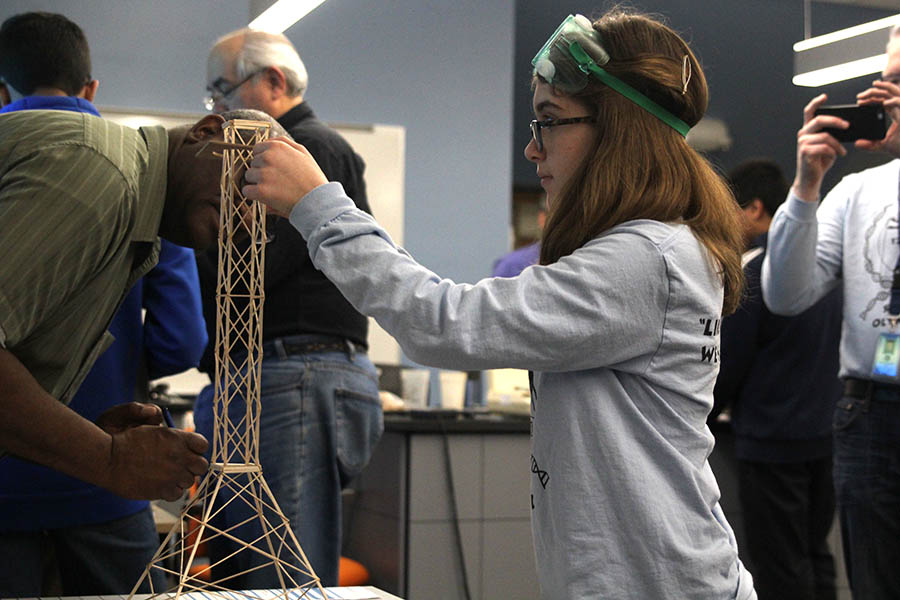 While showing the specifications of her tower, sophomore Eva Burke competes in the Tower event at the Science Olympiad regional competition at Johnson County Community College on Saturday, Feb. 24.