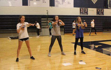 During fourth block on silver day, freshmen Tatum Elliot, Kylie Overbaugh and  Ella Greenup begin trying different moves to use for their aerobic dance routine on Monday, Feb. 5.
