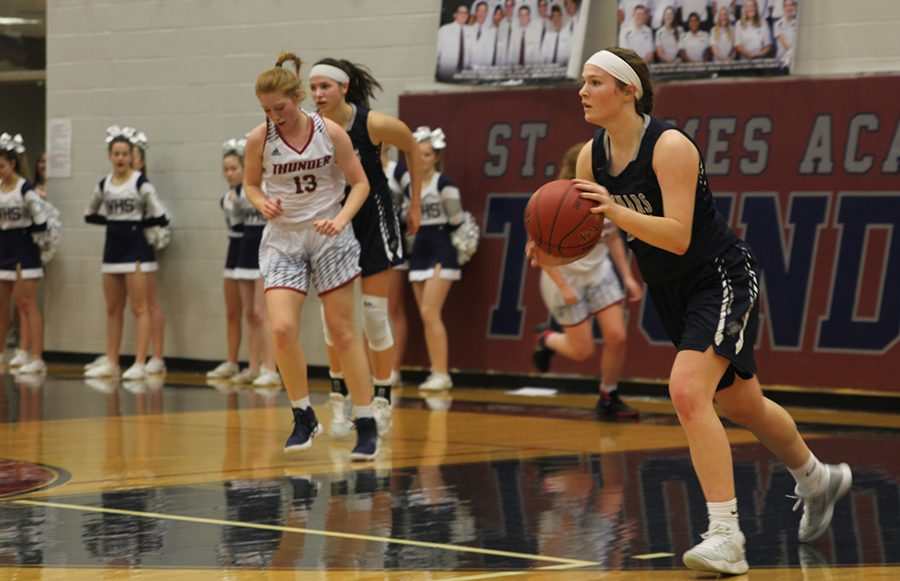 After+receiving+the+inbound+pass%2C+junior+starter+Claire+Kaifes+runs+with+the+ball+on+Friday%2C+Feb.+2+while+playing+against+St.+James.+