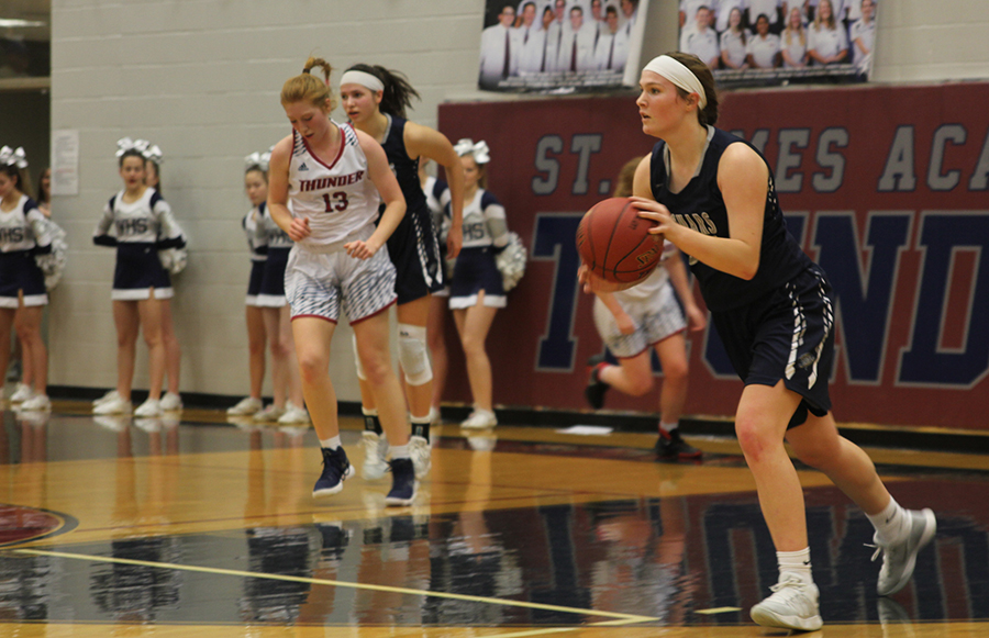 After receiving the inbound pass, junior starter Claire Kaifes runs with the ball on Friday, Feb. 2 while playing against St. James.